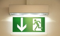 image of an illuminated emergency exit sign - Fire Safety Awareness