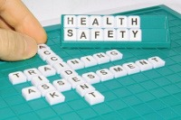 image of scrabble tile spelling out key element of a Health and Safety in the Workplace course
