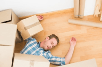 image of man under boxes with crush injuries