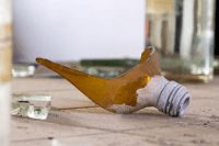 Image of a broken bottle containing a hazardous substance to illustrate the Control of Substances Hazardous to Health (COSHH) course